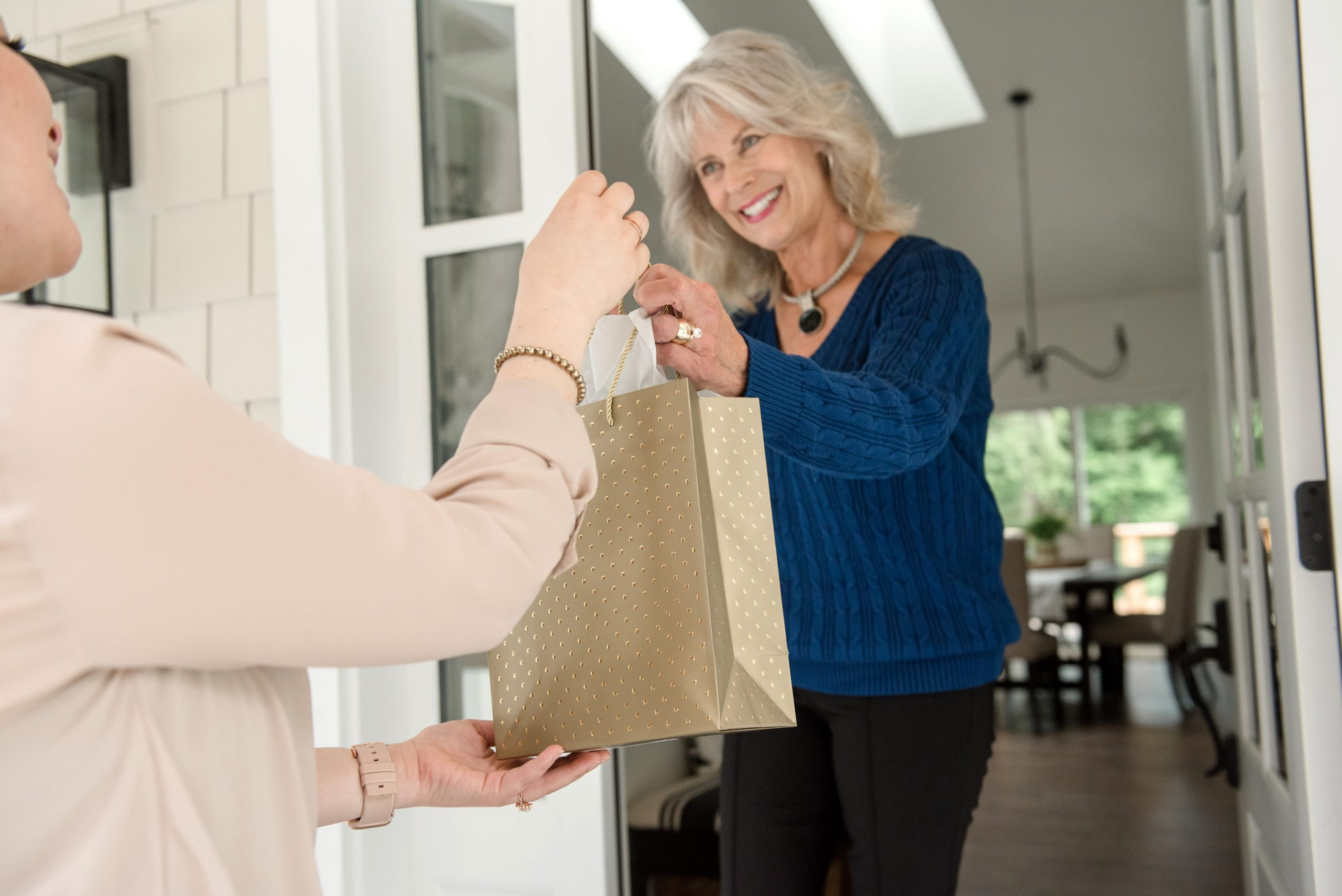 Holly Reynolds, Windermere, Real Estate, Whidbey Island, Washington, Passing gift with a smile